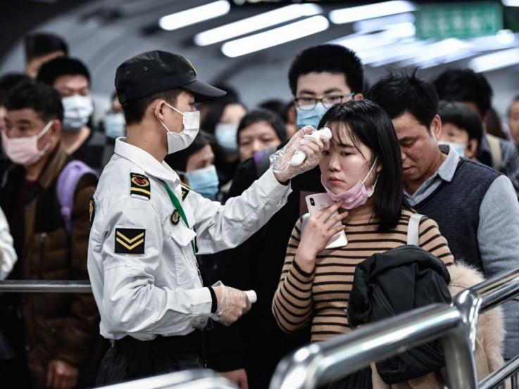 Oko 37 miliona ljudi u kineskim gradovima obuhvaćeno zabranom putovanja