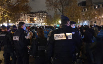 Police and migrants in Paris