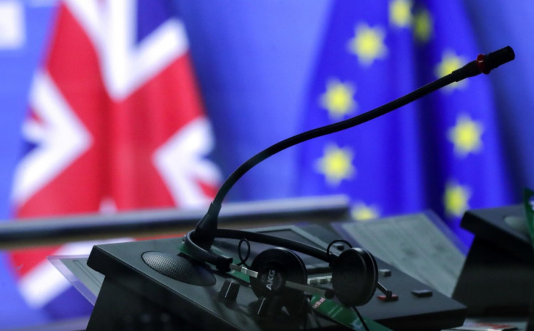 Flags of the Union Jack and European Union are seen through interpreters booth ahead of the meeting of European Commission President Ursula von der Leyen and British Prime Minister Boris Johnson, in Brussels, Belgium December 9, 2020.