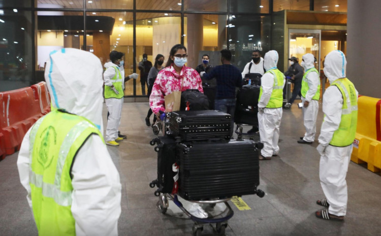 Passengers wearing protective face masks leave upon arrival at Chhatrapati Shivaji Maharaj International Airport after India cancelled all flights from the UK over fears of a new variant of the coronavirus disease (COVID-19), in Mumbai, India, December 22, 2020.