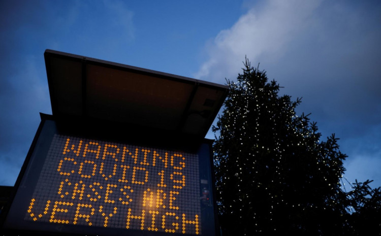 An electronic sign displays information as the British government imposes a stricter tiered set of restrictions amid the coronavirus disease (COVID-19) pandemic, in London, Britain, December 20, 2020.