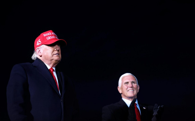 U.S. President Donald Trump and Vice President Mike Pence attend a campaign rally at Cherry Capital Airport in Traverse City, Michigan, U.S., November 2, 2020.
