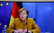 German Chancellor Angela Merkel speaks during a video conference at The Elysee Palace in Paris, France, January 11, 2021.