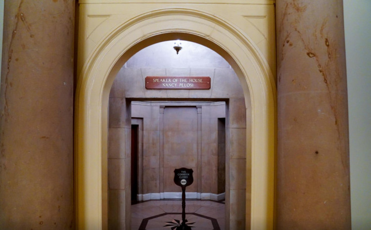 U.S. House Speaker Nancy Pelosi's office placard is replaced above her office after rioters vandalized it while storming the Capitol in Washington, U.S., January 17, 2021.