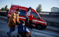 An ambulance carrying a COVID-19 patient is seen outside Santa Maria Hospital, during the coronavirus disease (COVID-19) pandemic in Lisbon, Portugal, January 18, 2021.