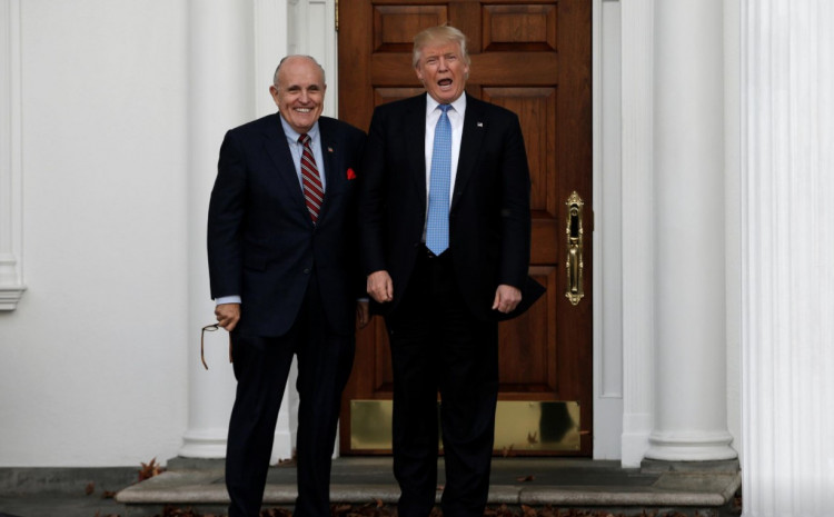 U.S. President-elect Donald Trump stands with former New York City Mayor Rudolph Giuliani before their meeting at Trump National Golf Club in Bedminster, New Jersey, U.S., November 20, 2016.