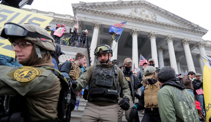 Jessica Marie Watkins (Left) and Donovan Ray Crowl (Center), both from Ohio, march down the East front steps of the U.S. Capitol with the Oath Keepers militia group among supporters of U.S. President Donald Trump protesting against the certification of the 2020 U.S. presidential election results by the U.S. Congress, in Washington, U.S., January 6, 2021.