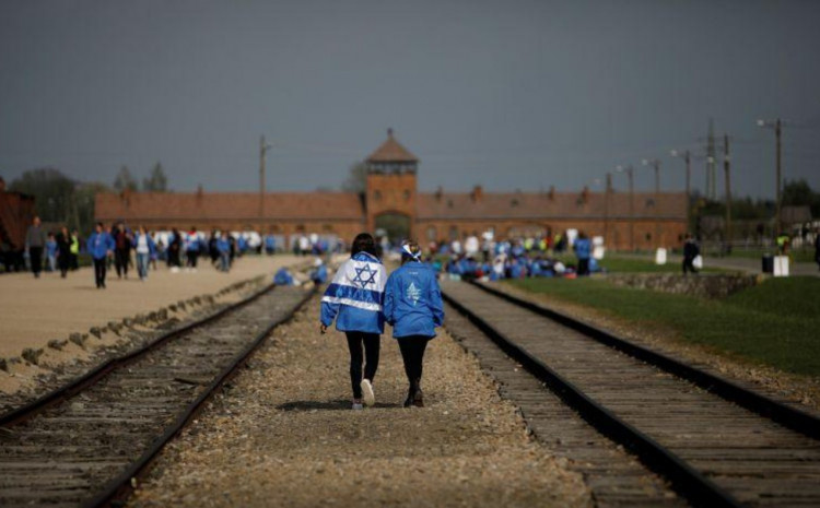 """Participants attend the annual """"March of the Living"""" to commemorate the Holocaust at the former Nazi concentration camp Auschwitz, in Brzezinka near Oswiecim, Poland, May 2, 2019."""