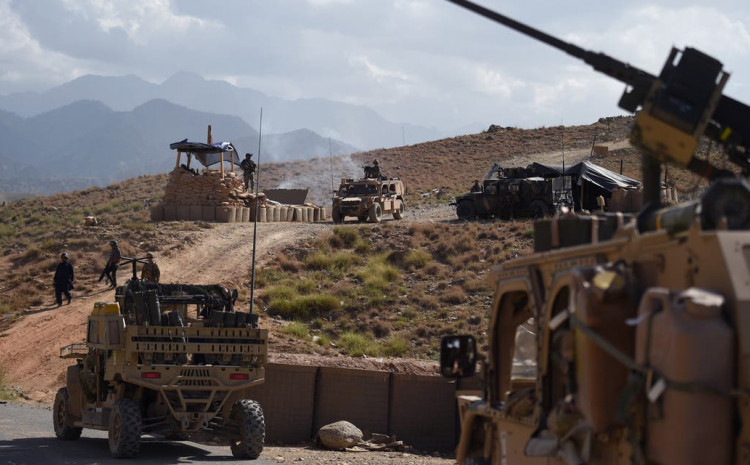 US, NATO, and Afghan commando forces at a checkpoint during a patrol against ISIS militants at the Deh Bala district in the eastern province of Nangarhar Province.