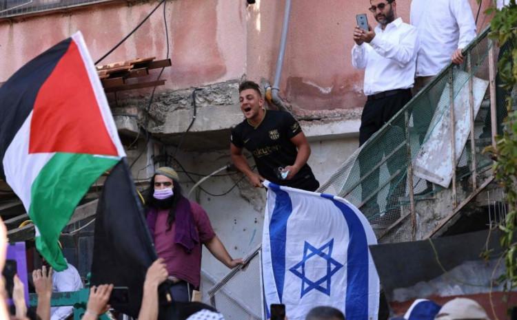 Israeli settlers in Sheikh Jarrah reacting as Palestinian and Israeli activists chant slogans in east Jerusalem on April 16, 2021.