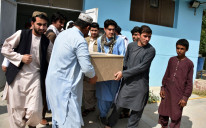 Relatives carry a coffin with the body of Nemat Rawan, a popular Tolo News talkshow host after he was shot dead by gunmen, in Kandahar Provicne on May 6, 2021.
