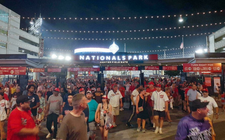 Spectators streamed out of the Nationals Park stadium as the game between the Washington Nationals and the San Diego Padres was interrupted due to a shooting outside the stadium