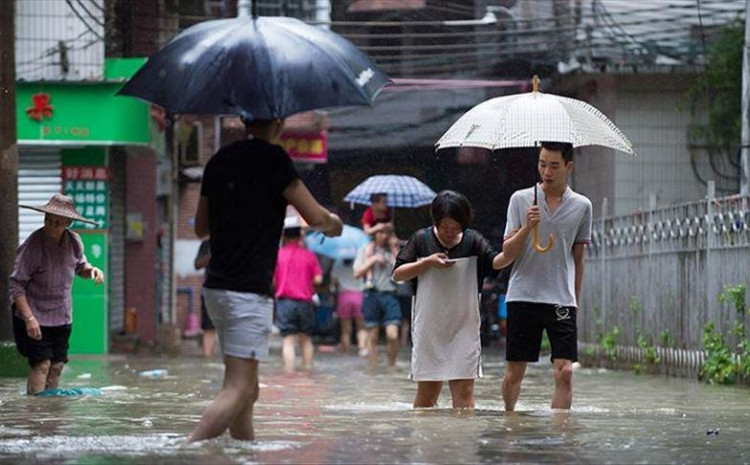 Torrential rains have battered Henan province since the weekend, causing rivers to burst their banks and flooding streets in several cities in the region