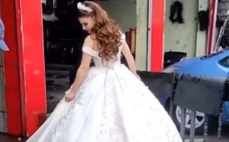 Mlada  oprala vjenčanica u autopraonici